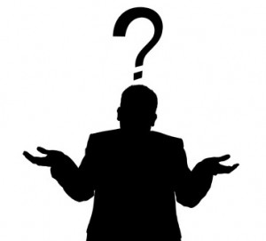 Silhouette of a man in a business suit giving a shrug with a question mark
